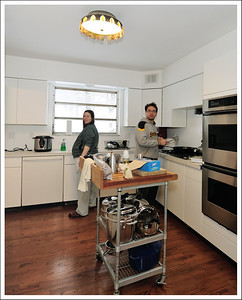 Kento and Cindy in their almost finished kitchen.