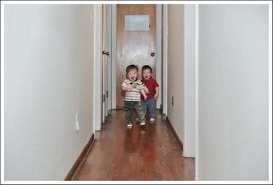 "They love running down this hallway.  It is actually outside of their ""safe play"" zone, so they take advantage of it when they get past the gate."
