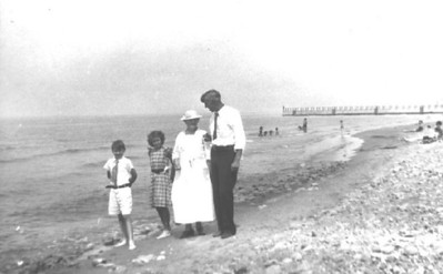 Great Uncle Bob, Grandma Mary, Great-Great Grandma Ella Bishop, Great Grandpere Perry Bishop.  My mom told me this was a Sunday at the beach of Lake Erie.  And she was just lucky she got to go barefoot!