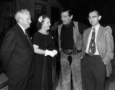 couple on left are people from Montgomery visiting the studio, Clark Gable, Uncle Rex