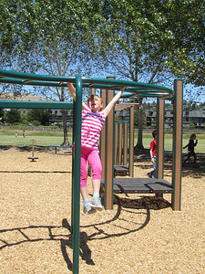Sofia on the monkey bars