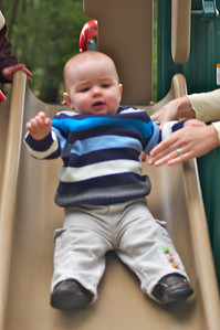 Edmund's first time playing on a slide. He really liked it!