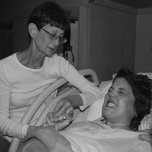 Mom with Michelle moments before Nadine's birth in 2006. Mom had only six more years of holding our hands before she needed us to hold hers.
