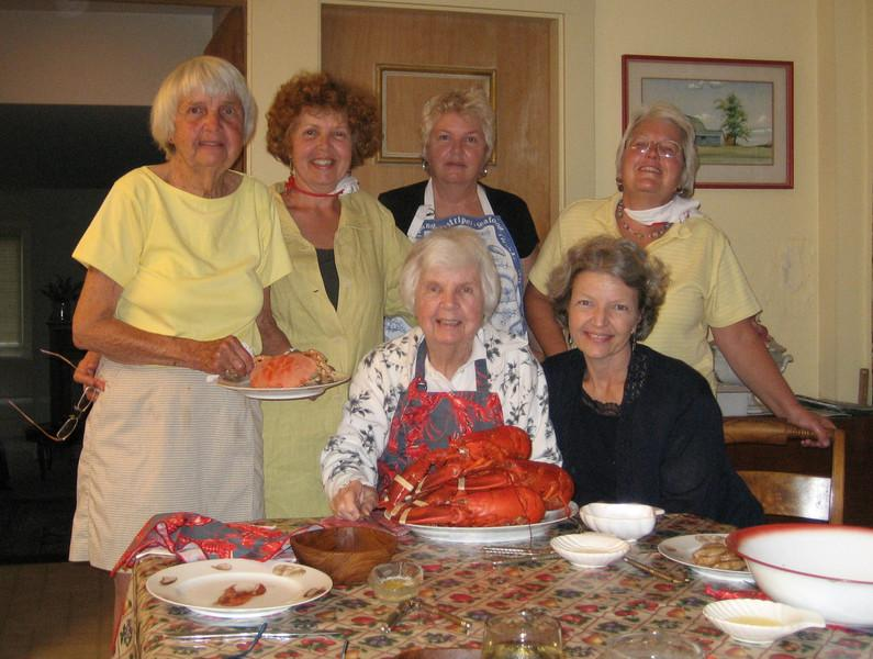 Lobster Lovers' Dinner at home!<br /> Sitting, from left are Mom and Carol. Standing, from left are Poppy, Laurie, Sandy, and Cathy. Note Poppy's painting of Grampie's barns in the background :-)