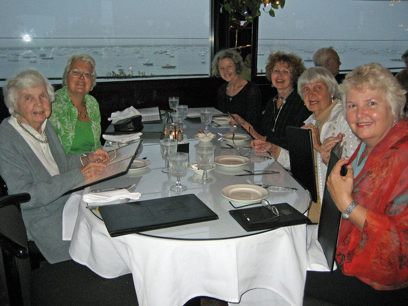 Sumptuous birthday dinner by Plymouth harbor.<br /> Left side is Mom, then Cathy.<br /> Right side at the back is Carol, then Laurie, Poppy, and Sandy at front right.