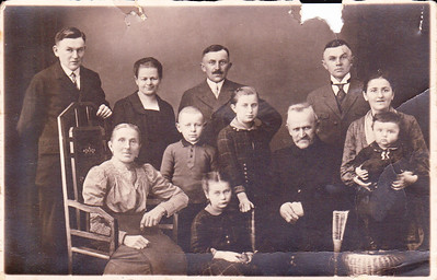 Birke Family Photo: Taken in Germany  First row: Edward (August's brother), unknown wife of oldest brother (Franz?), August Birke. Second Row: Grandmother (maybe Nelena Gerfch - whose face was added to photo), son + daughters of Franz, Grandfather (unknown name), Maria Treautler and Hilda Polfus.