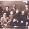 Birke Family Photo: Taken in Germany<br /> <br /> First row: Edward (August's brother), unknown wife of oldest brother (Franz?), August Birke.<br /> Second Row: Grandmother (maybe Nelena Gerfch - whose face was added to photo), son + daughters of Franz, Grandfather (unknown name), Maria Treautler and Hilda Polfus.