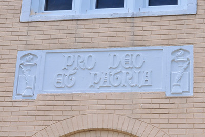 Pro Deo et Patria.  For God and Country.  On the exterior of the exterior of the Saint Aloysius school building.