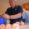 Uncle Larry butters up and shapes some popcorn balls