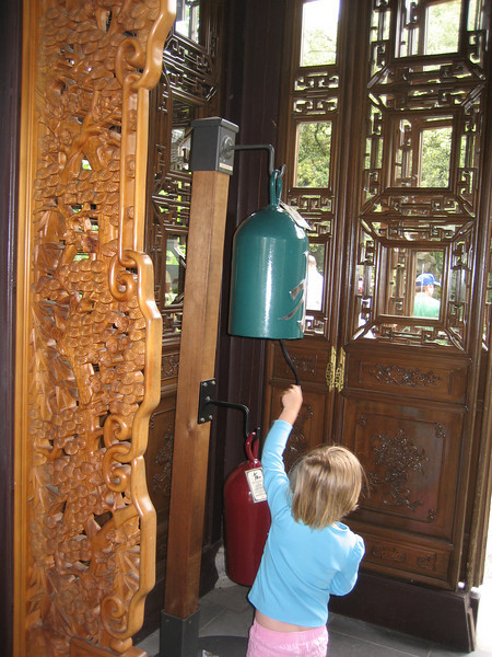 Syl ringing the gong, Portland Chinese garden.