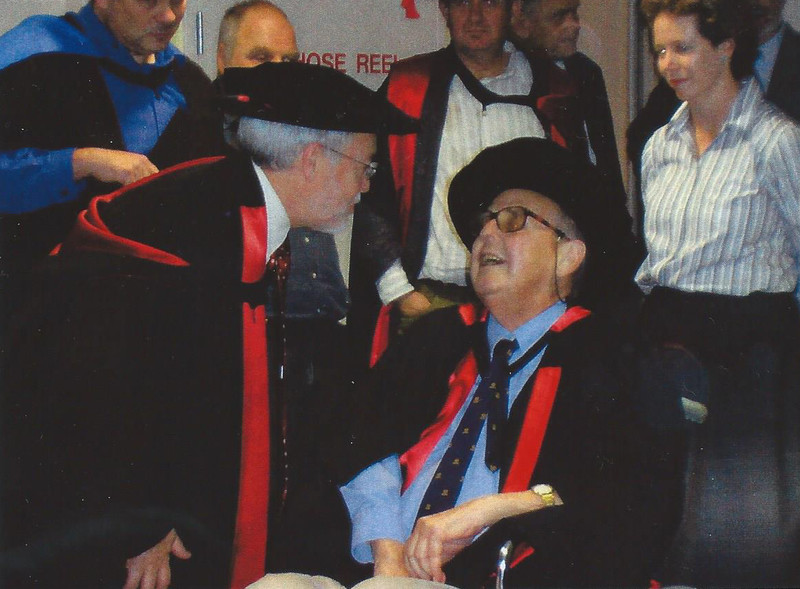 Conferring PhD to Don Roderick, Wesley Hospital, Brisbane, 2004. (Scan of Photo)
