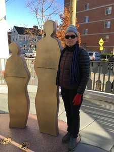 "Tonya chose to stand beside the figure bearing the message: ""I stand for those who suffered in the middle passage."""