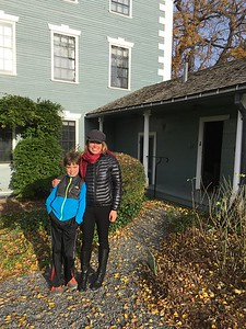 My daughter and grandson standing in back yard of the Moffat-Ladd House, where some of their ancestors had once lived.  The tree beyond was planted in 1776, and is still alive!
