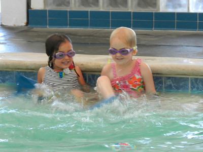 Brooklyn and Allegra having fun at swimming lesson