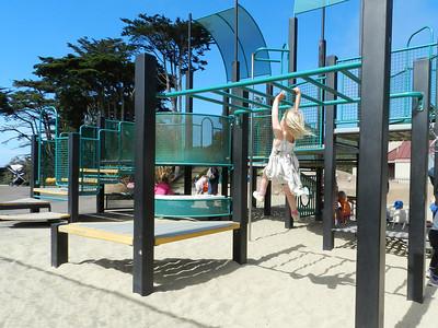 Allegra flying across the monkey bars
