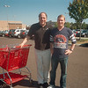 Friendly black-shirted Target Security officer escorts the Giants Fan safely out of the store