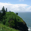 6/18  This is the lighthouse at Cape Disappointment; at the mouth of the Colombia.  This is where Lewis and Clark wintered after crossing the country.  The cape, however, was named by a British sea captain who discoverd it some 30 years before.