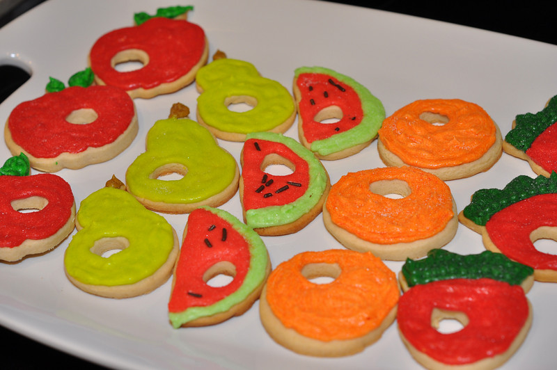 Very Hungry Caterpillar cookies... with caterpillar holes eaten out of them!