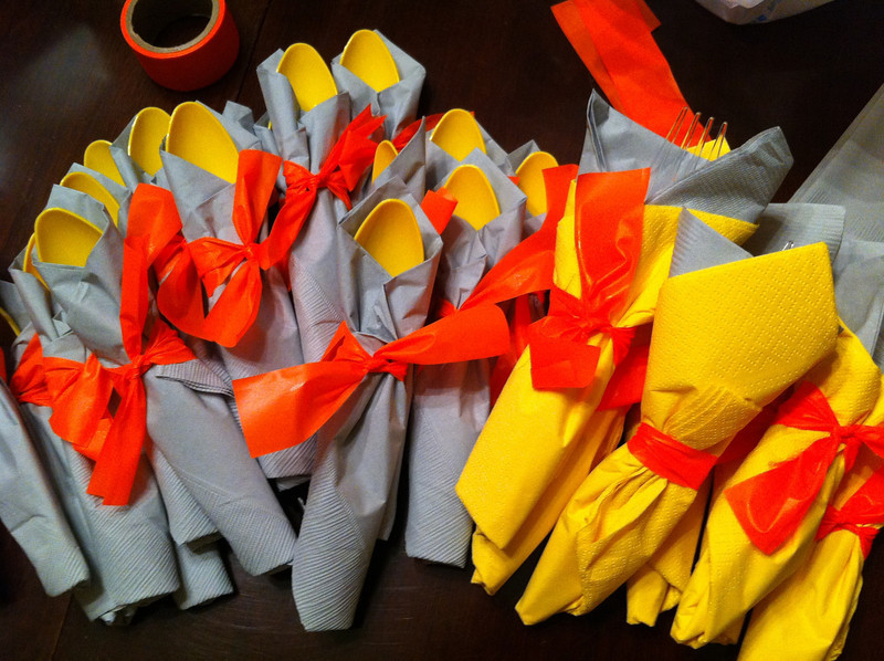 Party color scheme: orange, yellow, and silver! Forks and spoons look cute tied with orange flagging (thanks, Pops!)