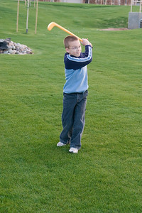 Cayman finishing his swing