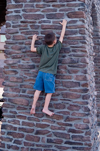 Merek climbing the veranda wall