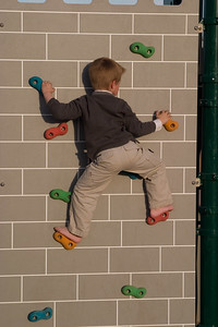 Connor climbing the climbing wall