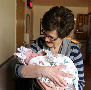 Kathy holding granddaughter, Quinn 3-26-13.
