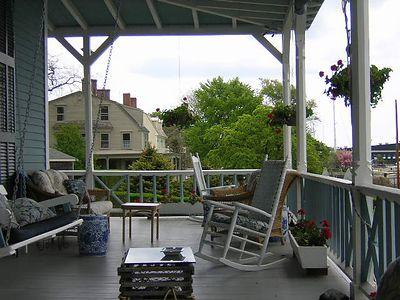 lazy Sunday resting on the porch at Sanford-Covell Villa Marina, 72 Washington Street, Newport; looking south