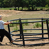 "Country living makes a body strong. Memom showed us how she can easily lift this solid steel thing. It's called a ""hay ring"" because it's designed to hold the large, round bales of hay."