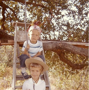 Dad built a platform for us in the branches of an oak tree behind the ranch house.  This was our private tree house