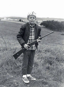 Here I am with my first BB gun.  I remember shooting down a swallow's nest from the eve's of the house and feeling terrible when the baby birds inside the nest fell to their deaths.