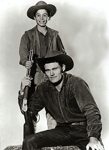 The Rifleman was one of my favorite Western TV shows because it fetured a kid who was about my age.  You could almost guarentee that the Rifleman would have to use his gun to kill one or two bad guys before the TV show ended.  Here is a link to the openning credits:  http://www.youtube.com/watch?v=wDedUcmvgL8&NR=1