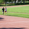 Adult runners in training - running 64 second 400 meter segments