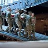 Honor guard carries casket from transport at Dover AFB