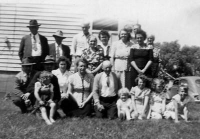 Rasmussen- Sorensen gathering about 1945 Linda, Laura, Mabel, Jens, Janet, Joanne, Darlene, Marge - in front Pete, Earl, Russell, Kristine, Delores, Hulda, Walter, Howardene., Helene - in back
