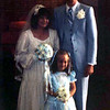 wedding bride & groom with flower girl