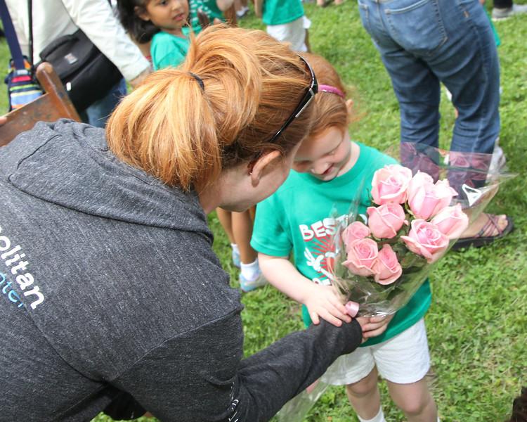 Mama Darcey bestowing a pink dozen on her precious!