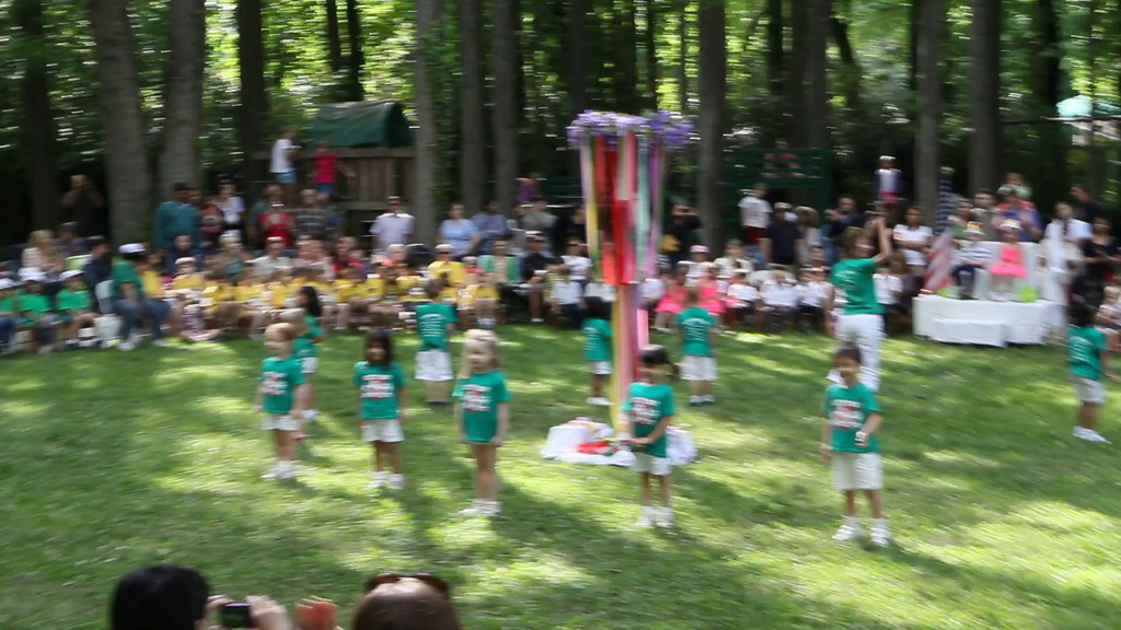 """Reagan and her fellow 4 year olds show off their moves at their """"Maypole"""" graduation from pre-K school."""