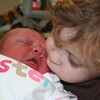 Giving baby sister a kiss