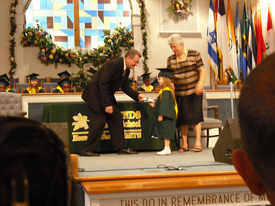 Getting her diploma from the Pastor