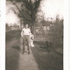 """Back of photo reads """"Bob Tannahill."""" The man kneeling behind Bob is unidentified. Photo apparently taken in Franklin, Illinois(?)."""
