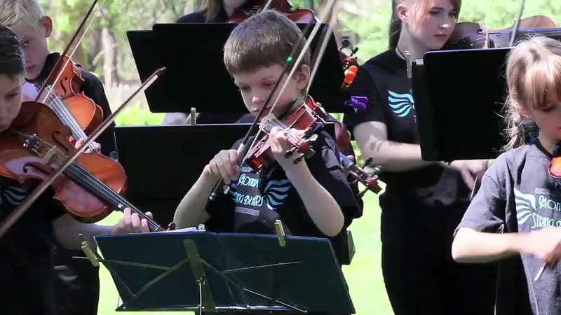 Hayden played with his Violin teacher's group, The Monument String Blazers, for a fund raising event in downtown Colorado Springs.  This is part one of the video.