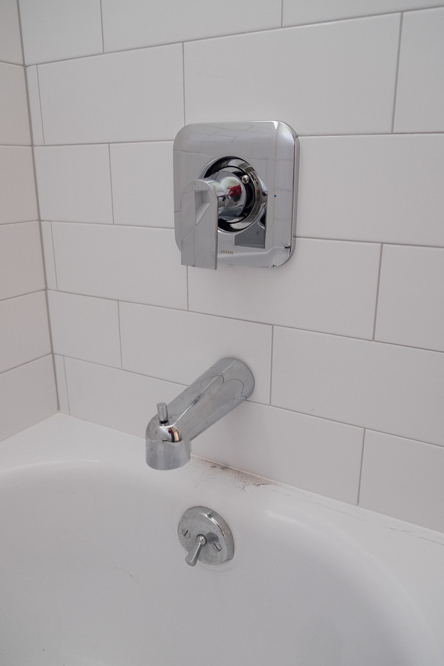Guest bathroom tub fixtures.