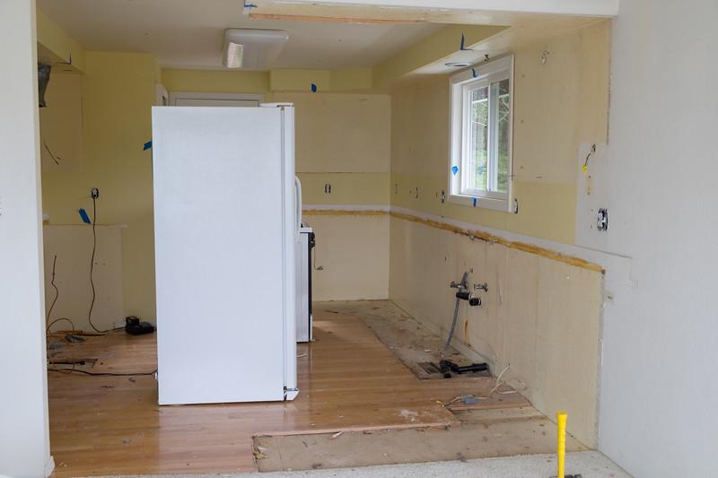 Kitchen fairly empty.