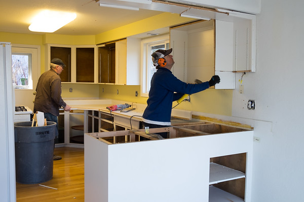 Kitchen cabinets going away. Scott Larson in the orange headphones is the GC for the project.