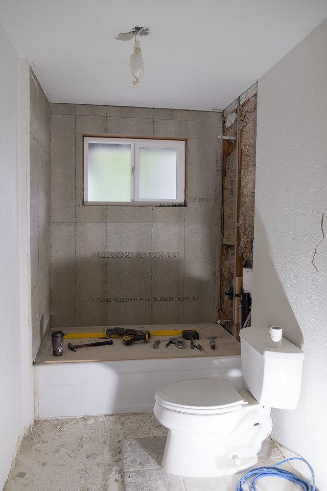 The shower walls in the guest bathroom going up.