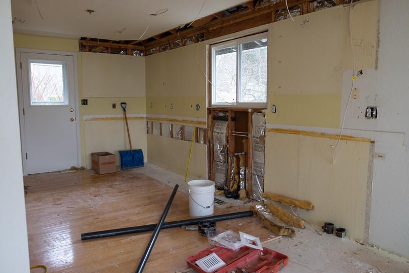 Kitchen plumbing work underway.
