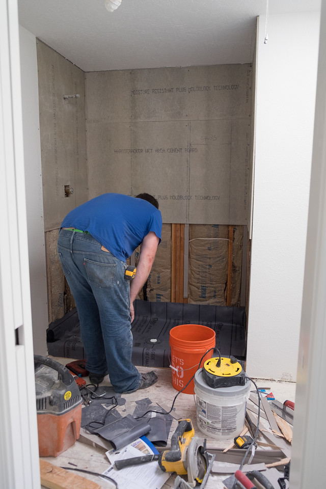Tile guy building master shower.