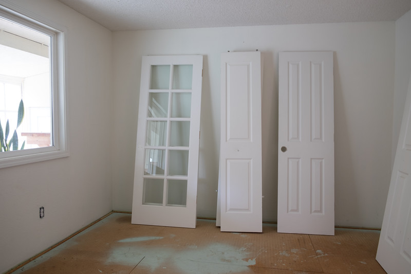 Doors are off and waiting for paint in the guest bedroom.