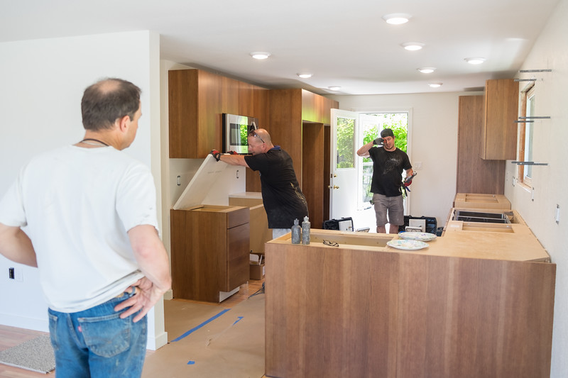 Scott at left supervising the counter install.